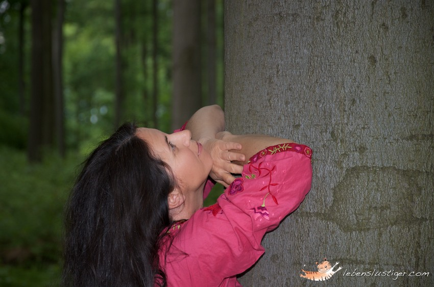 girl hugging tree and logging at it